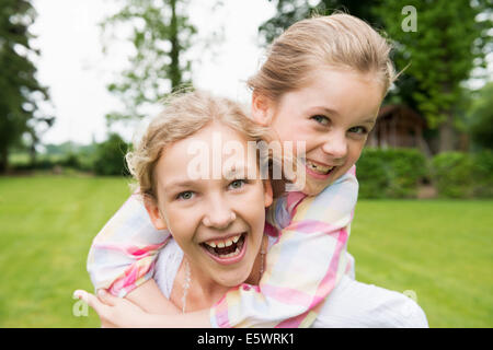 Two sisters hugging, portrait - Stock Photo