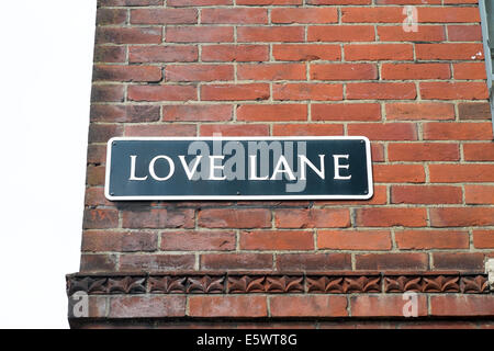 Love Lane street name sign on side of red brick building UK - Stock Photo