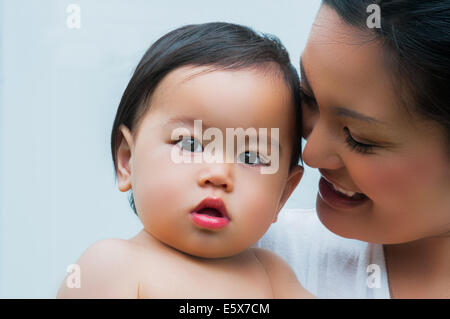 Close up portrait of mother and baby boy - Stock Photo