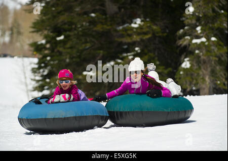 Suzanne and Lucy Weiss enjoy their time tubing at Snowbird Resort in Utah. - Stock Photo