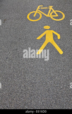 Symbols on a road, bikes and pedestrians - Stock Photo