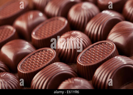Assorted delicious chocolate pralines background - Stock Photo