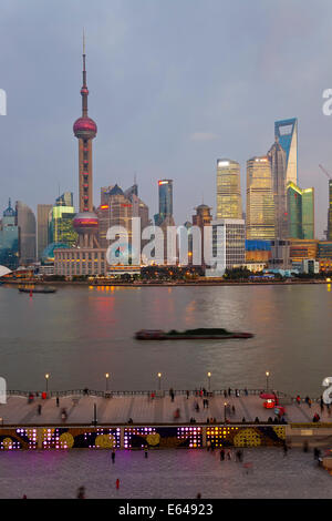Barges and Pudong skyline at dusk, Shanghai, China - Stock Photo