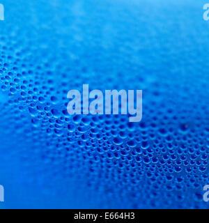 Water drops on blue bottle background - Stock Photo
