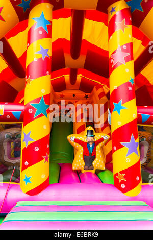 Amusements bouncy castle on the High Street Redcar Cleveland UK in school holidays - Stock Photo