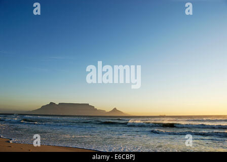 Table Mountain from Blouberg beach at sunset, South Africa - Stock Photo
