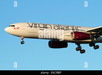 Virgin Atlantic Airways Airbus A330-300 on final approach at sunset - Stock Photo