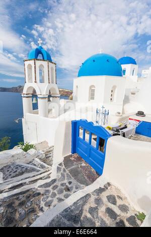 Blue roof church of Oia, Santorini Grecce - Stock Photo