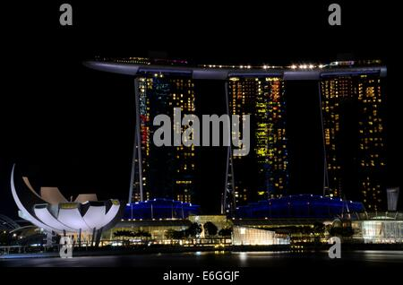 Marina Bay Sands integrated resort hotel casino and ArtScience Museum in Singapore Marina Bay on Singapore River - Stock Photo