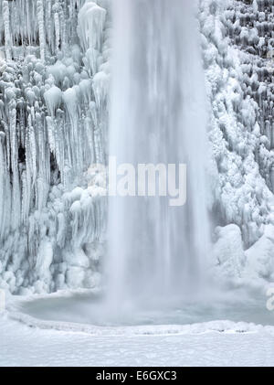 Close up of Horsetail Falls with ice and snow. Columbia River Gorge National Scenic Area, Oregon - Stock Photo