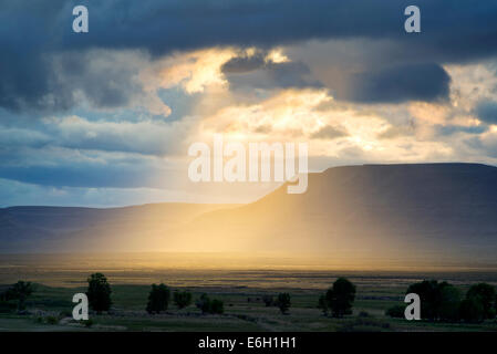 Sunburst through clouds in Harney County, Oregon. - Stock Photo
