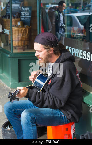 Busker playing guitar at Pike Place Market, Seattle. - Stock Photo