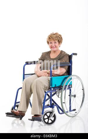 beautiful senior woman sitting on wheelchair isolated on white background - Stock Photo