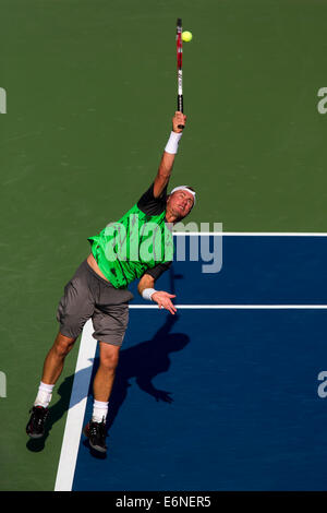 Flushing Meadows, NY, USA. 27th Aug, 2014. Lleyton Hewitt (AUS) in first round action at the US Open Tennis Championships. - Stock Photo