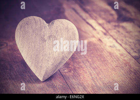 Vintage style heart on rustic wooden background, copy space. - Stock Photo