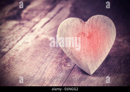 Vintage style heart on rustic wooden background, text space. - Stock Photo