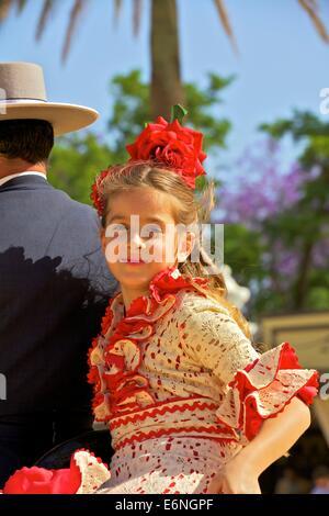 Girl in Traditional Spanish Costume, Annual Horse Fair, Jerez de la Frontera, Cadiz Province, Andalusia, Spain - Stock Photo