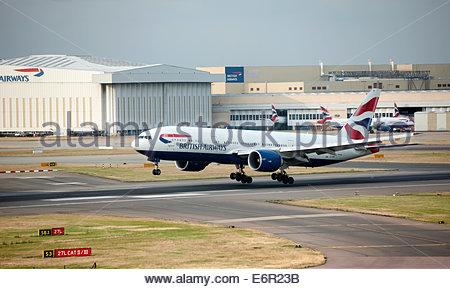 London UK London Heathrow Airport (LHR) British Airways Boeing 777 G-VIIB coming in to land. - Stock Photo