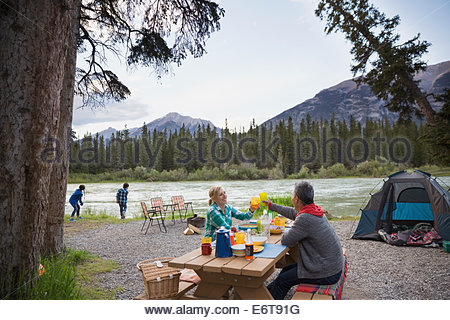 Family relaxing together at campsite - Stockfoto