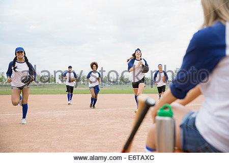 Baseball team running on field - Stock Photo
