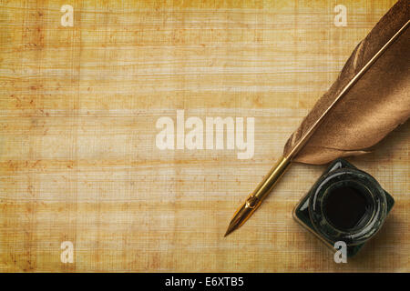 Old Paper and Feather Quill with Glass Ink Bottle and Copy Space. - Stock Photo