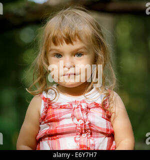 Little girl in the forest - Stock Photo