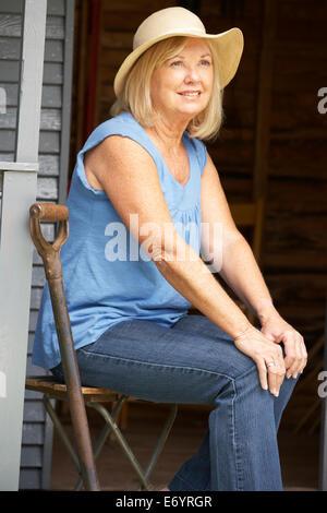 Senior Woman Sitting On Veranda Stock Photo Royalty Free