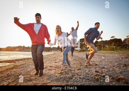 Group of friends having fun on beach - Stock Photo