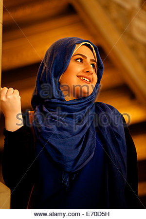 Photo of a beautiful girl, taken on stairs in Chatsworth House - Stock Photo