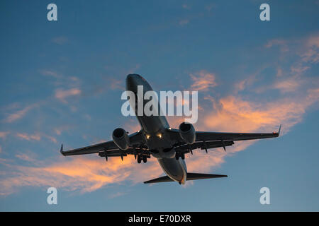 Commercial airliner Boeing 737 jet on final approach for landing-Victoria, British Columbia, Canada. - Stock Photo