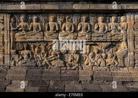 Borobudur, Java, Indonesia.  Bas-relief Stone Carving, North Face.  Scenes from the Buddha's Life Show him Seeking - Stock Photo
