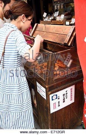 Senbei stand,near Arai Yakushi temple,Nakano,Japan - Stock Photo