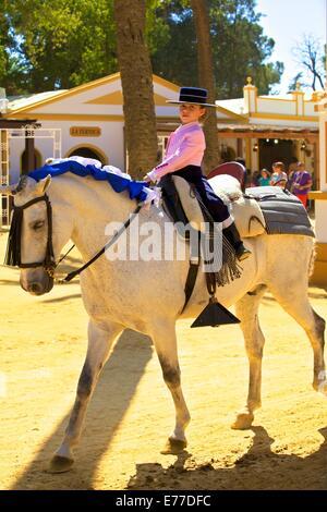 Girl in Traditional Spanish Costume on Horse, Annual Horse Fair, Jerez de la Frontera, Cadiz Province, Andalusia, - Stock Photo