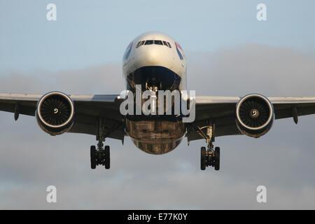 boeing 777 head on approach landing BA - Stock Photo