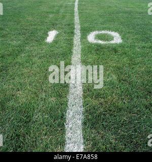 The ten yard line on an American football field - Stock Photo
