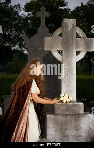 Victorian scene of a mourning lady at a tombstone (text on tombstone has been replaced) - Stock Photo