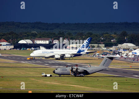 Airbus A380-841 and Airbus A400M Atlas at Farnborough International Airshow 2014 - Stock Photo