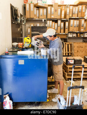 Man Recycling Used Motor Oil At Auto Parts Store Usa Stock Photo Royalty Free Image 73439101