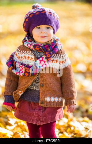 Happy little girl walking in the autumn park - Stock Photo
