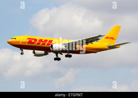 DHL Cargo Airbus A300 approaches runway 27L at London Heathrow airport. - Stock Photo