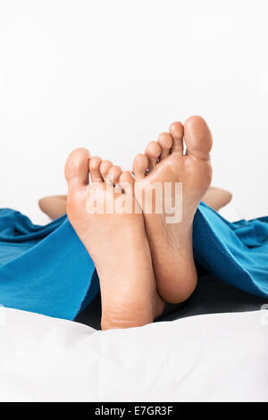 Female Feet On A White Back Ground Showing The Arch Of The