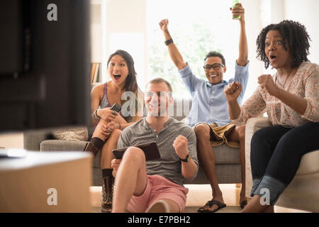 Group of friends watching television - Stock Photo