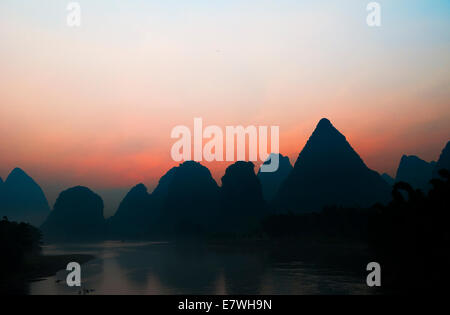 Sunrise over the Karst mountains along the Li river in Yangshuo, Guangxi, China. - Stock Photo