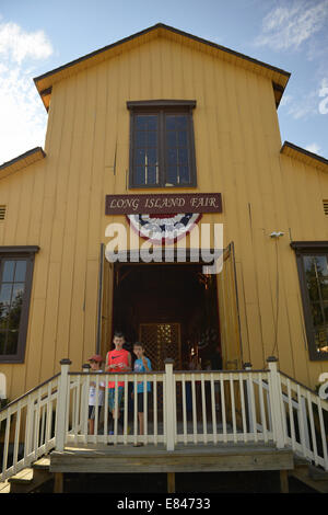 Old Bethpage, New York, USA. 28th Sep, 2014. Three young boys are at the front entrance of the Exhibition Hall at - Stock Photo