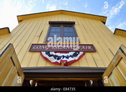 Old Bethpage, New York, USA. 28th Sep, 2014. Above the Exhibition Hall entrance, patriotic red white and blue bunting - Stock Photo