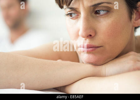 Woman angry and resentful following dispute with husband - Stock Photo