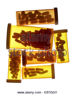 Different medical bottles of pills & tablets isolated on white - Stock Photo