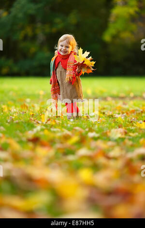 Little girl walking in the park - Stock Photo