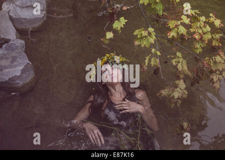 Young beautiful woman in river - Stock Photo