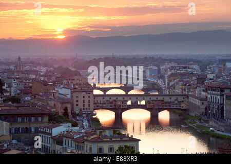 Sunset view over Florence and the Ponte Vecchio from Piazza Michelangelo, Florence, UNESCO Site, Tuscany, Italy - Stock Photo